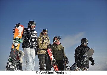 snowboarders group relaxing and enjoy sun
