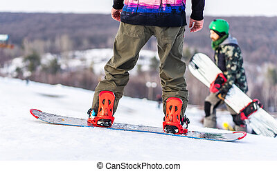 Snowboarders on track