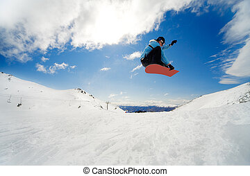 Snowboarding action - Snowboarder jumping through air on ...