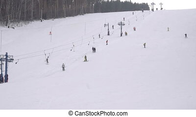 Snowboarding downhill slow - BELOKURIKHA, RUSSIAN FEDERATION...