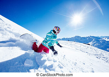 Snowboarding fail - Female snowboarder wearing colorful...