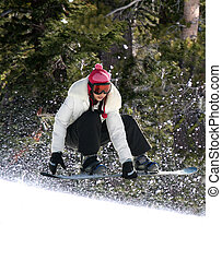 Snowboarding in a forest - Snowboarder jumping high at Lake...