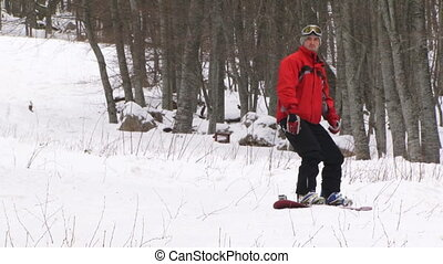 Snowboarding in a winter forest