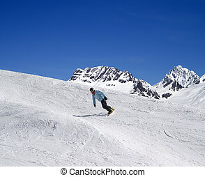 Snowboarding in high mountains