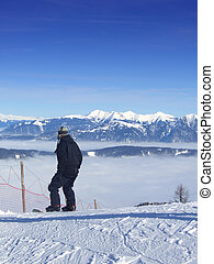 Snowboarding over the clouds