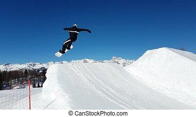 Snowboarding Snowboard Snowboarder at jump mountains at...