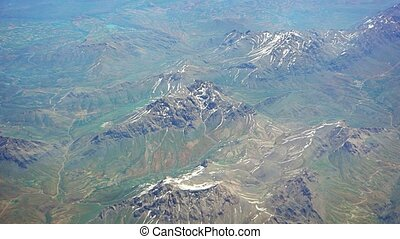 High altitude perspective of massive mountains with snowy peaks in this remote region of Turkey.