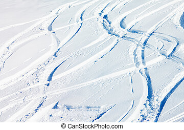 Snowcapped mountain with a lot of ski-tracks