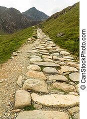 Snowdon stone flagged path up to peak of Snowdon Miners track.
