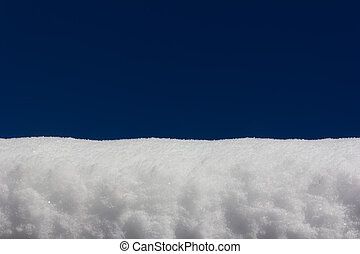 snowdrift on blue sky background close-up, with copy space