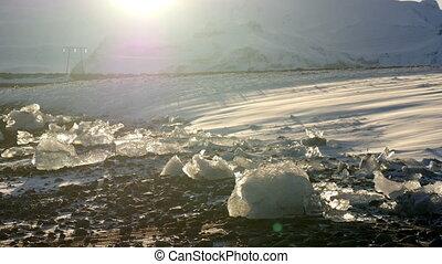 Snowdrift through small icebergs wi - Heavy wind blows snow...