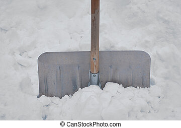 Snowe shovel - Close up of aluminum snow shovel in deep snow