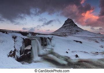 Snowed kirkjufell mountain in winter in Iceland