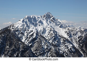 mountains with white snow in winter in the Northern Italy -...