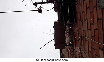 Snowfall along red brick house wall - Snowfall from milky...