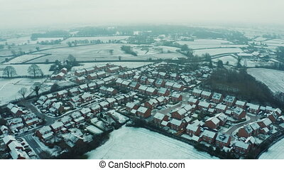 Snowfall and whiter fog over small English rural village in countryside, Cheshire UK. Christmas 2020. Early morning
