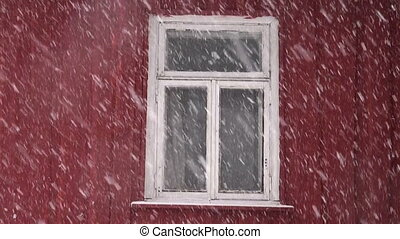 Snowfall and window in village
