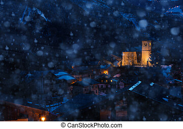 Snowfall in Champagny-en-Vanoise village church