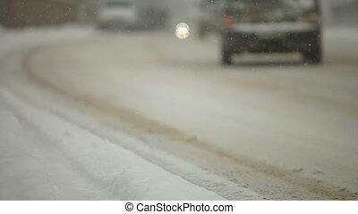 snowfall on city road