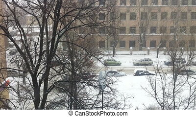 Snowfall on city street, high angle view