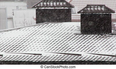 Snowfall on roofs