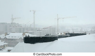 Snowfall over high rise building - Urban winter landscape -...