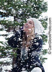 snowfall - Portrait of young beautiful woman on winter...