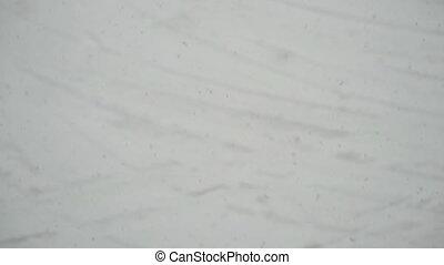 Snowfall slow motion. Slowly falling snowflakes