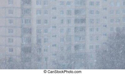 Snowfall, soft fluffy snow falls asleep building, northern...