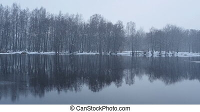 snowfall winter landscape River forest reflection snowfall...
