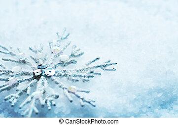 Snowflake in snow. Christmas