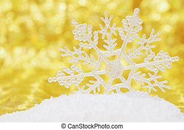 snowflake in snow gold background
