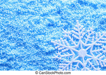 Snowflake in snow