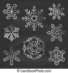 Snowflake silhouettes on chalkboard background, hand drawn...