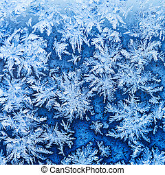 snowflakes and frost on window glass close up - snowflakes ...