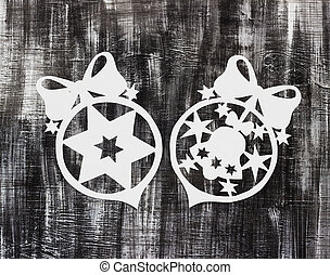 Snowflakes cut out of paper on dark background with space for text Christmas theme