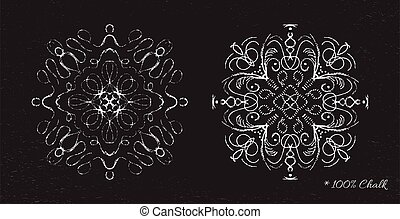 Snowflakes drawn in chalk on a black background