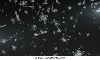 Snowflakes falling against black background - Digital...