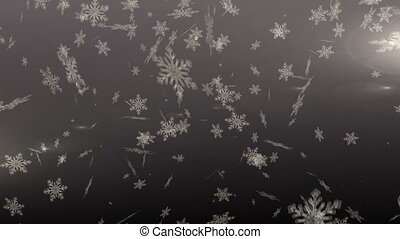 Snowflakes falling against grey background - Digitally...
