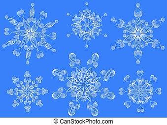 Snowflakes in the technique of quilling .