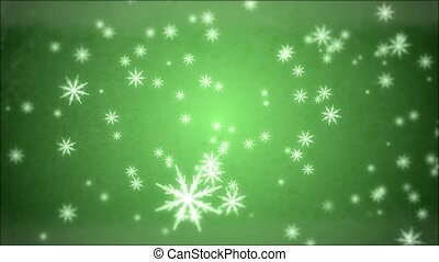 Snowflakes - Large snowflakes are falling against a green ...