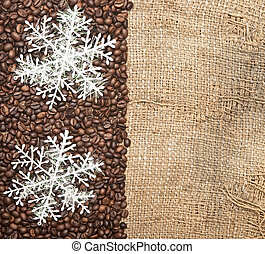 Snowflakes on coffee beans with copy space for your text