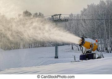 Snowgun makes snow - Snowcannon making snow at mountain...