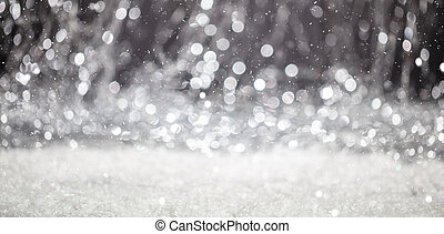 Snowing, Christmas time. Abstract bokeh lights background