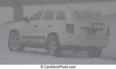 Snowing Hard on a White Jeep Car - Closeup of a jeep truck...