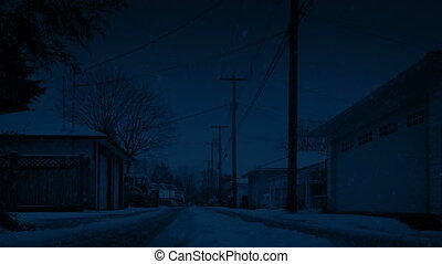 Snowing On Road Behind Houses At Night