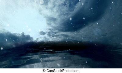 Snowing on Stormy Clouds Over Dark Ocean