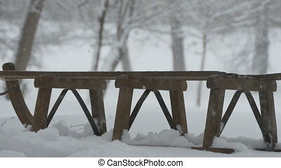 Snowing on Wood Sleigh - View of a wooden vintage sleigh ...