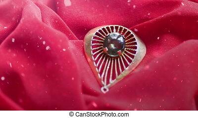 Snowing over diamond ring on satin