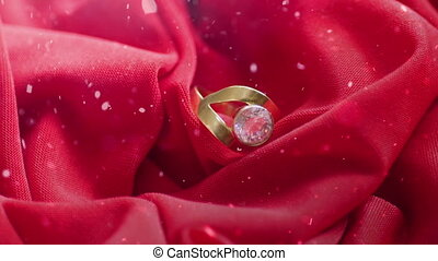 Snowing over diamond ring on satin